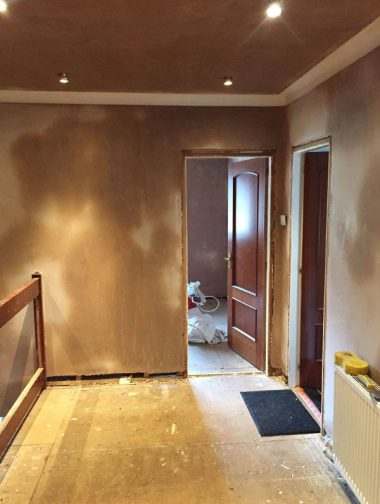 Hallway after skimming and coving